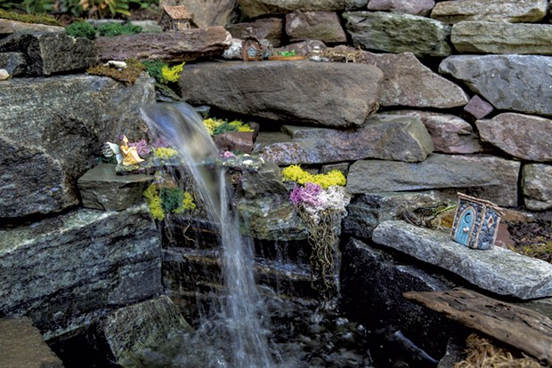 A waterfall graces the fairy garden Sawyer built for Mavis. - JAMES BUCK