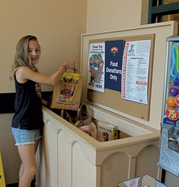 Hannah Smiley making a donation to the Milton Food Shelf (Activity 60)