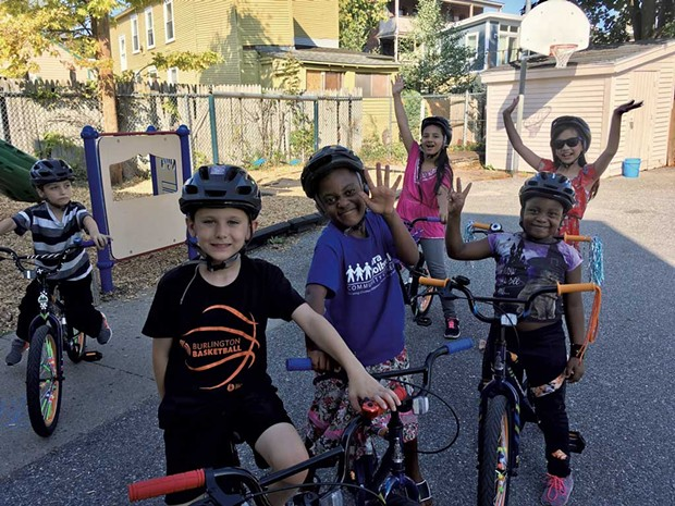 Kids in Sara Holbrook's elementary afterschool program bike in the center's back lot - COURTESY OF SARA HOLBROOK COMMUNITY CENTER