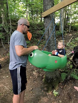 Dan Huskes and son Jayce stop by for a swing - BRETT STANCIU