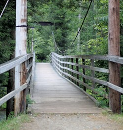 The suspended bridge at River of Life Camp - COURTESY OF RIVER OF LIFE CAMP