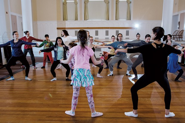 UVM and Project Prima students practice ballet positions during practice in Ira Allen Chapel - SAM SIMON