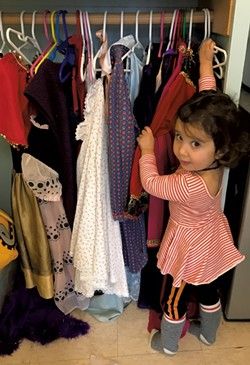 The space includes a collection of dress-up clothes - BRETT STANCIU