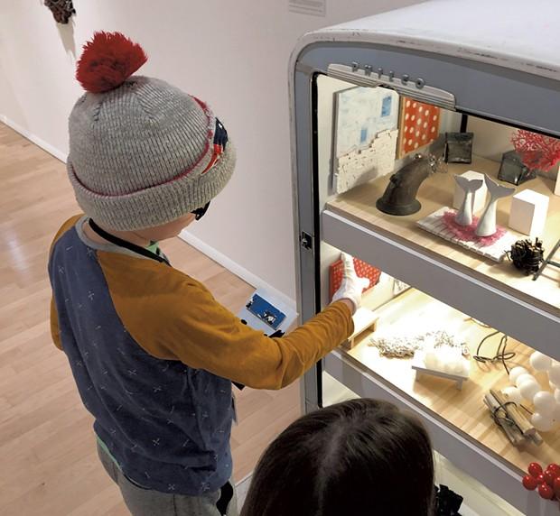 Henry checks out Matt Neckers' open refrigerator - HEATHER POLIFKA-RIVAS
