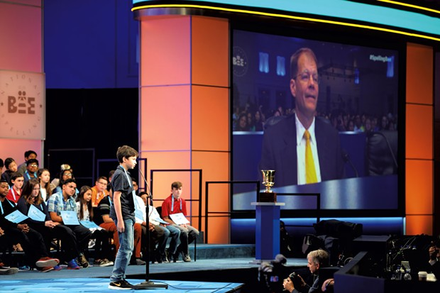 Dr. Jacques Bailly on the big screen at the 2018 Scripps National Spelling Bee - COURTESY OF MARK BOWEN/SCRIPPS NATIONAL SPELLING BEE