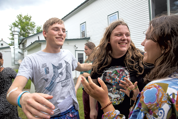 ReTribers Peter Orzech, Riley Craig and Maddie Parker (left to right) embrace on the final day of Inner Journeys - JAMES BUCK