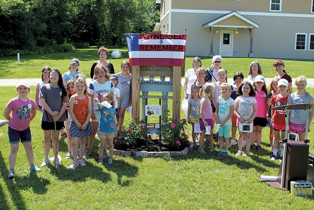 Girls at Camp Farnsworth flank the new Rosie the Riveter garden - COURTESY OF GIRL SCOUTS OF THE GREEN AND WHITE MOUNTAINS