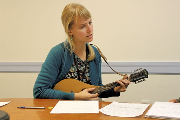 Mary Bonhag strums her mandolin, putting music to words - COURTESY OF LUND