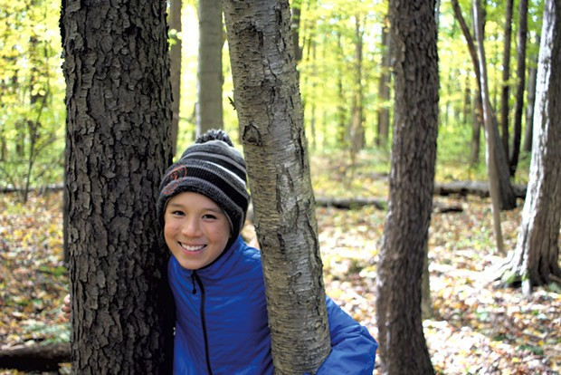 Jesse with a black cherry tree, left, and yellow birch tree, right - HEATHER FITZGERALD