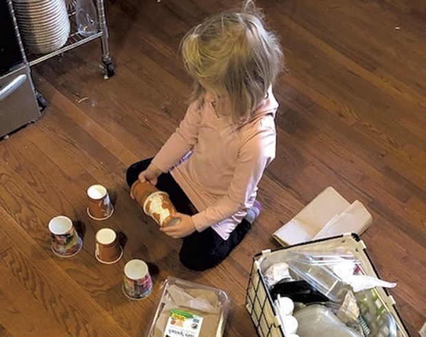 Meredith's daughter explores materials in the family's reuse zone - MEREDITH BAY-TYACK