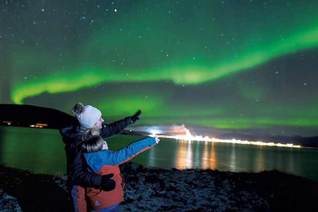 Max and his mom viewing the Northern Lights from the Arctic Circle