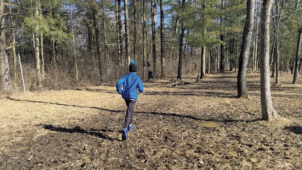 Heather's son, Jesse, explores a muddy field - COURTESY OF BEN WANG