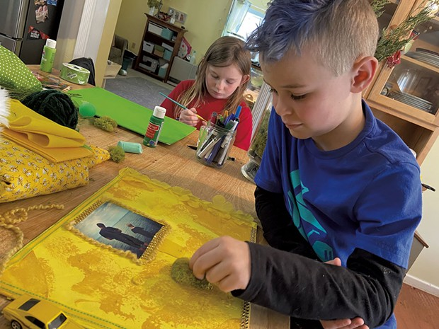 Maggie and Aidan creating collages - COURTESY OF TRISH VAN VLIET