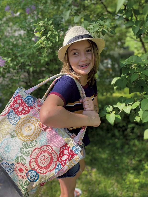 Sophie carrying her family's picnic basket - TRISH VAN VLIET
