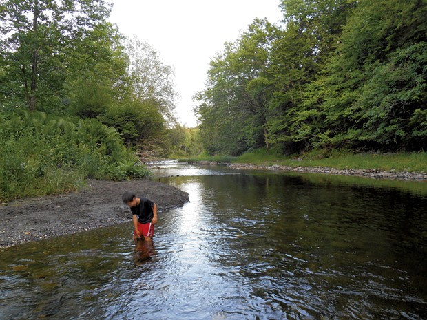 Heather's son Jesse wading in Québec's Tomifobia River in 2014 - HEATHER FITZGERALD