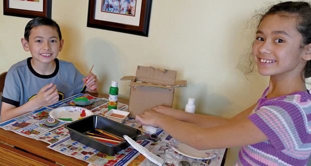 Ethan and Sophia painting rocks at their home in St. Albans