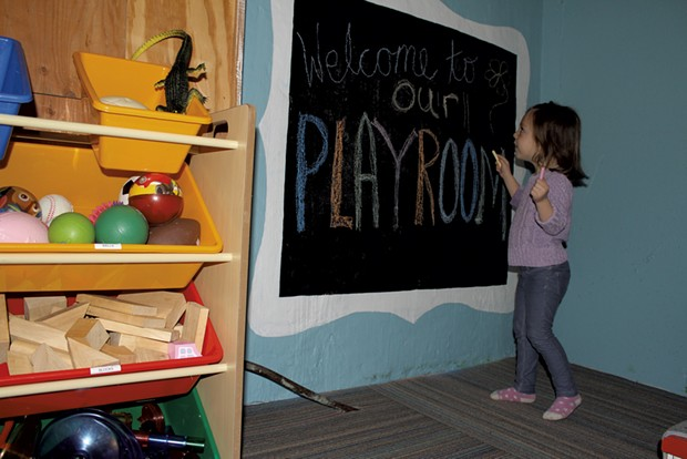 Sophie coloring on her chalkboard - MARY ANN LICKTEIG