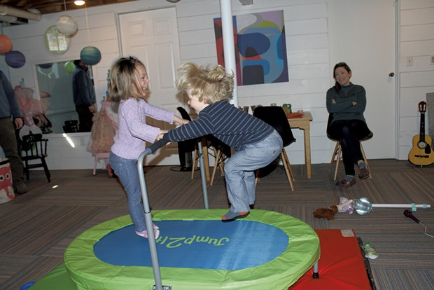 Mom Antonia looks on as her kids jump on the trampoline - MARY ANN LICKTEIG