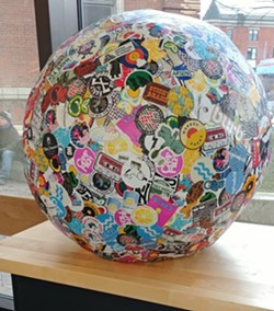 Courtesy of Fletcher Free Library - THE WORLD'S LARGES STICKER BALL, ON LOAN FROM STICKY BRAND