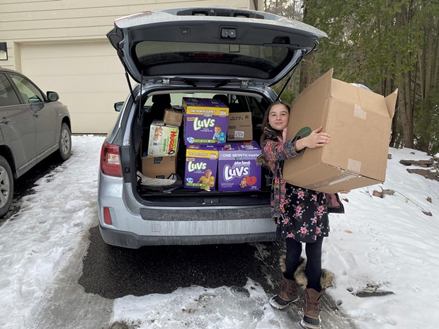 Zoe delivering a carload of supplies