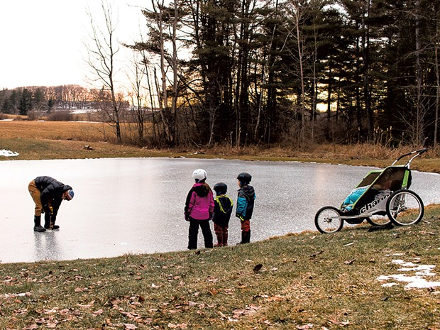 Measuring the backyard pond's ice - KATE FARRELL