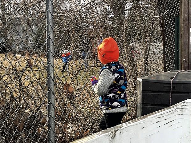 Keegan's daughter Coraline watches from afar as neighbors play - KEEGAN ALBAUGH