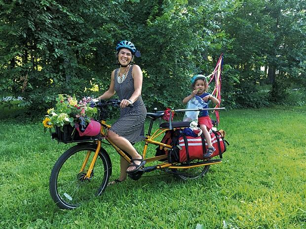 Sueno LeBlond and Autumnrose on a cargo bike - COURTESY OF CAITLIN BURLETT