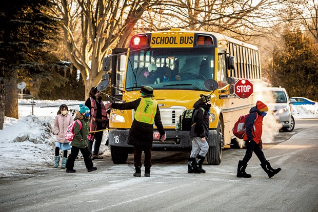Elementary students exiting the school bus - CAT CUTILLO
