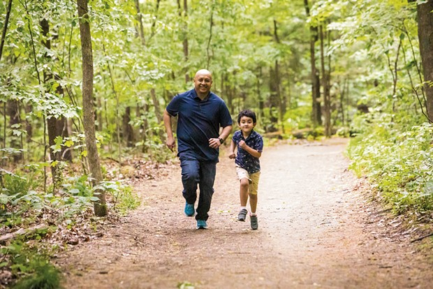 Rija Ramahatra and his son, Mathéo, at Niquette Bay State Park in Colchester - CAT CUTILLO