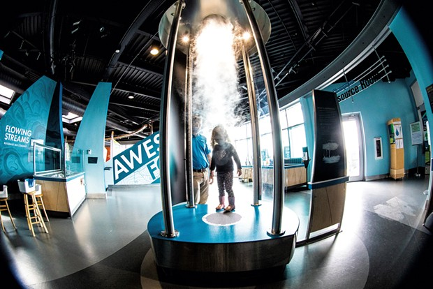 """Chris and daughter Charlotte exploring ECHO'S tornado vortex, part of the """"Awesome Forces"""" exhibit - CAT CUTILLO"""