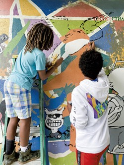 Painting the mural - COURTESY OF RORY JACKSON