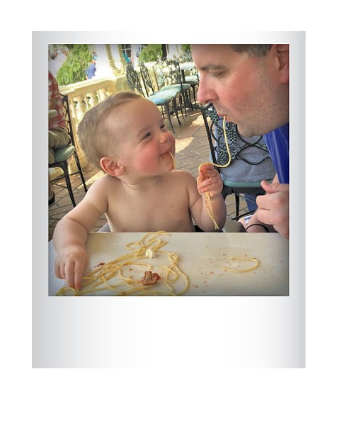 Joe Victory and son, Jackson, slurping pasta at Disney World in March, 2015. Submitted by Sara Victory, Winooski