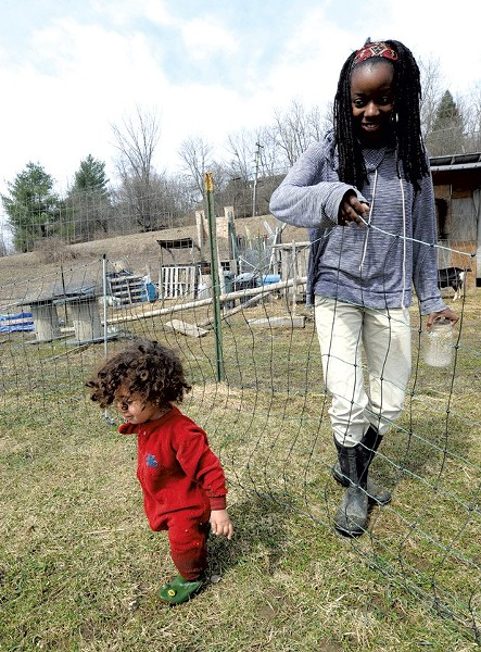 Daycare operator Marlena Tucker-Fishman and her son, Ezrah, in April 2014. - FILE PHOTO BY JEB WALLACE-BRODEUR