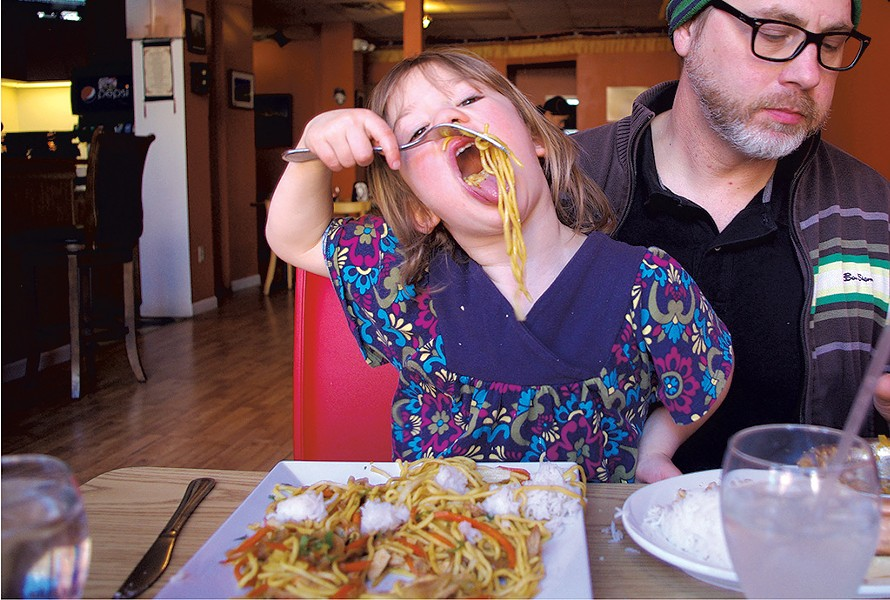 Mila enjoying chow mein - COURTESY OF MEREDITH COEYMAN
