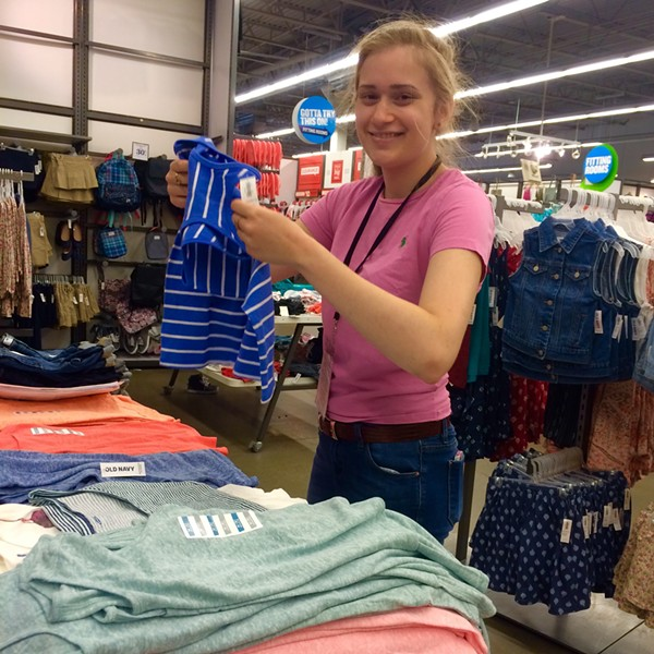 Drew Coel folding clothes at Old Navy - ANDIE PINGA