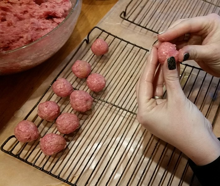 Rolling the meatballs