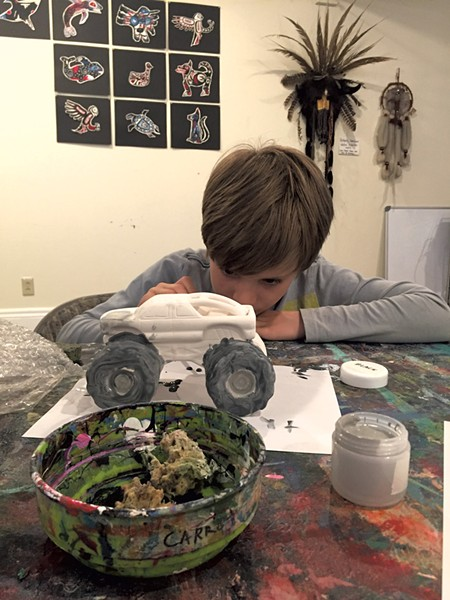 Theo paints his monster truck - ALISON NOVAK
