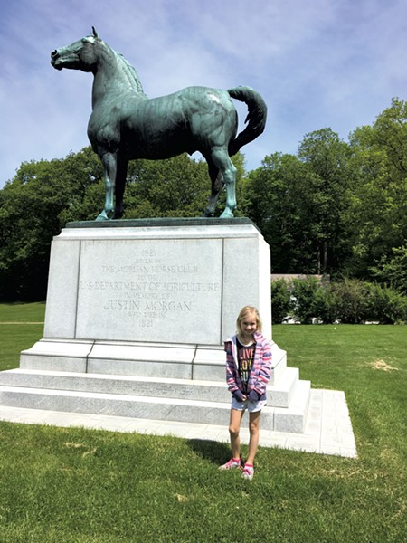 Dillon with a statue of Figure - SARAH TUFF DUNN