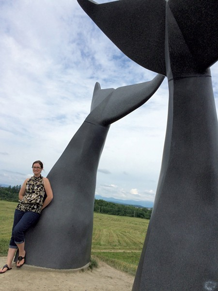 """Erin Rounds in front of the """"Reverence"""" sculpture in South Burlington - COURTESY OF ERIN ROUNDS"""