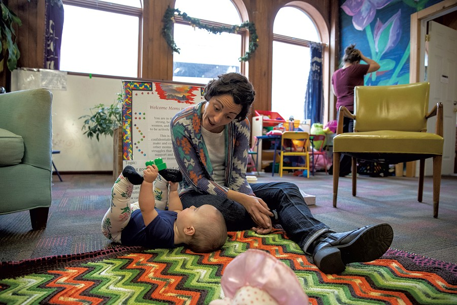 Kelly Breeyear plays with a baby at the New Moms in Recovery Program she runs at Turning Point - JAMES BUCK