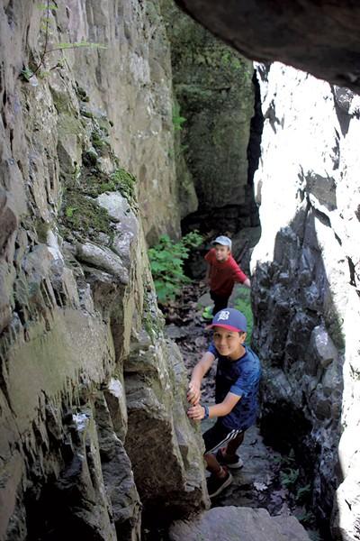 A deep, narrow cave makes for a perfect climbing spot - HEATHER FITZGERALD
