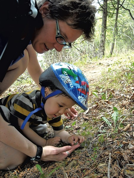 Heather and Jesse look for bugs at Rock Point in Burlington - HEATHER FITZGERALD