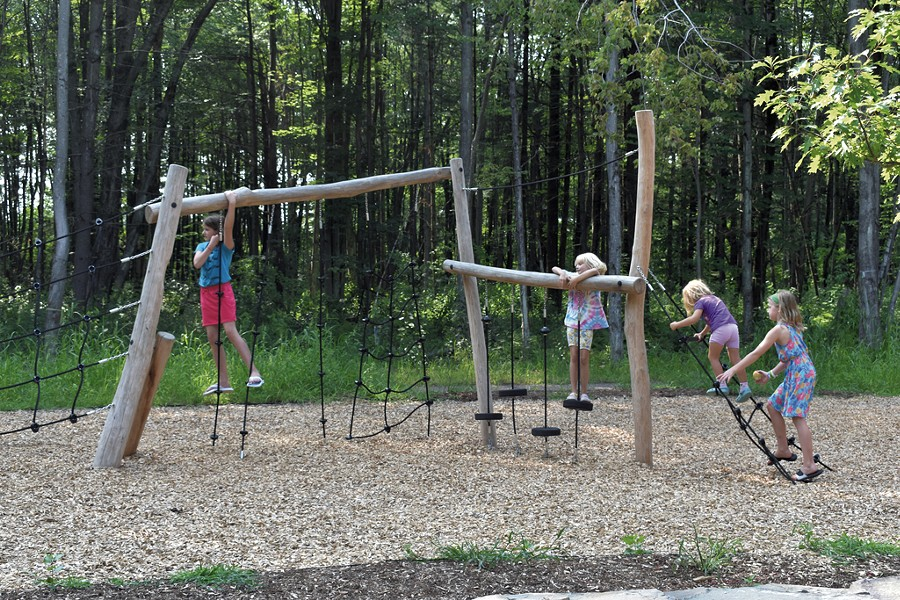 Kids play on the obstacle course during City Center Park's 2018 grand opening - COURTESY OF SOUTH BURLINGTON RECREATION & PARKS