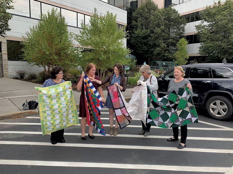 Joyce Irvine, right, with members of the Quilting Queens of National Life Group - COURTESY OF JOYCE IRVINE