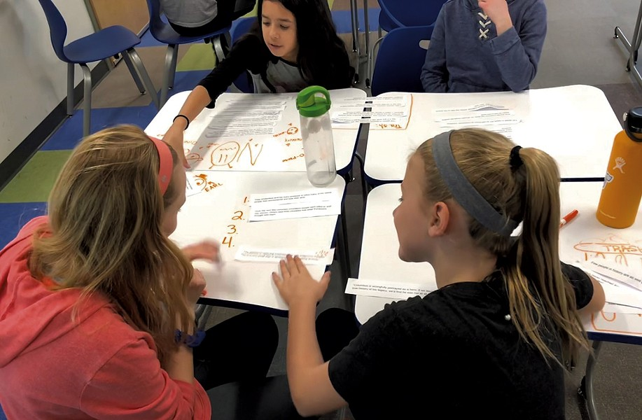 Middle school students at Shelburne Community School work on the evidence learning target