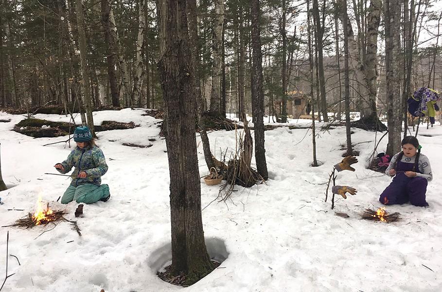 Katie Lane-Karnas' children practicing their fire-making technique - COURTESY OF KATIE LANE-KARNAS