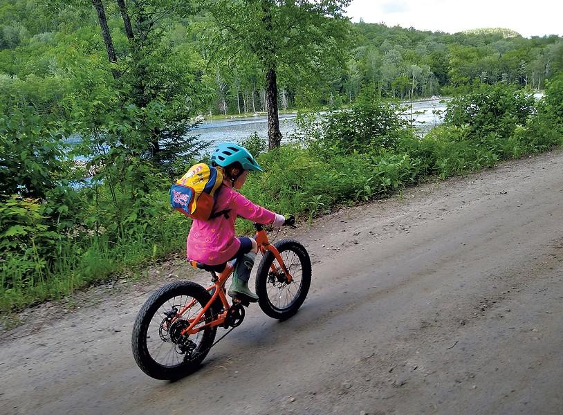 Sarah's daughter Elise on the Cross Vermont Trail - TRISTAN VON DUNTZ