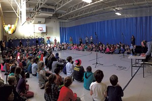 The students of Champlain Elementary School record a song for the album