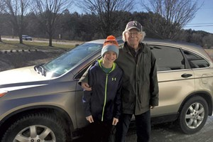 Tom Thompson with grandson Owen heading out on their last Meals on Wheels delivery in April