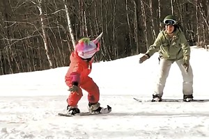 Jess Wisloski snowboards with her daughter at Middlebury Snow Bowl